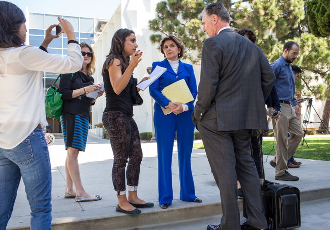 Attorney Gloria Allred, in blue suit, outside the courthouse in Santa Monica, Calif., after a motions hearing in Judy Huth's lawsuit against Bill Cosby. Credit Monica Almeida/The New York Times